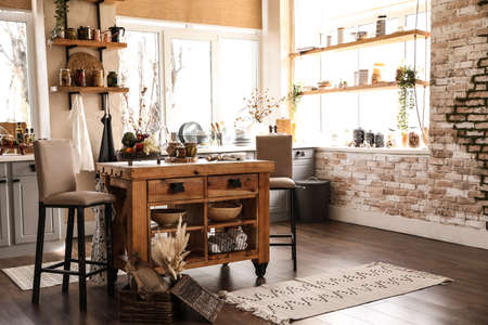 Stylish kitchen interior with wooden table and chairs