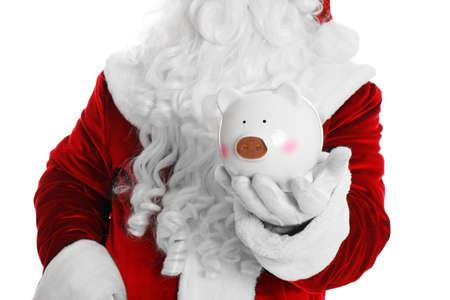 Święty Mikołaj trzyma skarbonkę na białym tle, zbliżenie Zdjęcie Seryjne
