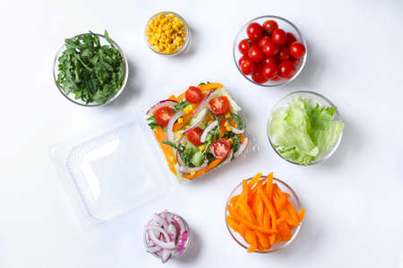 Fresh salad and ingredients on white background, top view