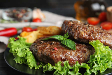 Grilled meat cutlets for burger on table, closeup Stock Photo