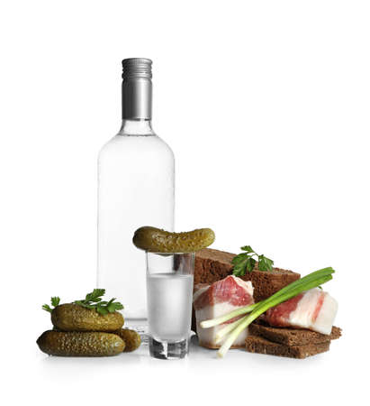 Russian vodka and different appetizers isolated on white