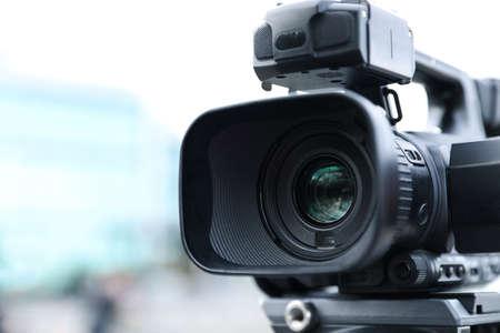 Professional video camera on city street, closeup 版權商用圖片