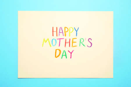 Greeting card with text Happy Mother's day on light blue background, top view Standard-Bild - 133958321