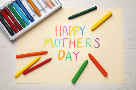 Greeting card for Mother's day and crayons on white wooden background, flat lay Standard-Bild - 133960271