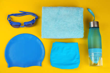 Flat lay composition with swimming accessories on yellow background Stock Photo