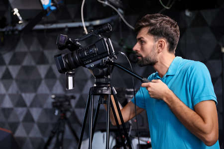 Professional video camera operator working in studio
