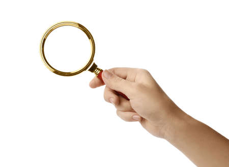 Woman holding magnifying glass on white background, closeup
