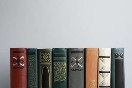 Collection of old books on light background