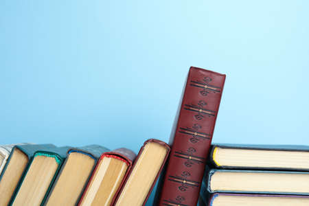 Collection of old books on light blue background