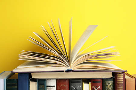 Collection of old books on yellow background