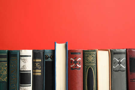 Collection of old books on red background