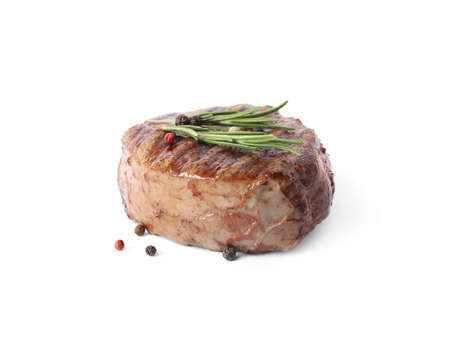Delicious grilled beef medallion with rosemary and peppers mix isolated on white
