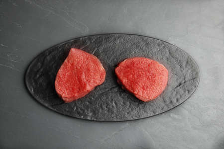 Fresh raw beef cut on black table, top view Stock fotó