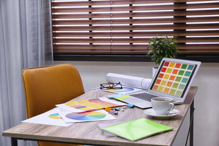 Modern designer's workplace with stylish new laptop
