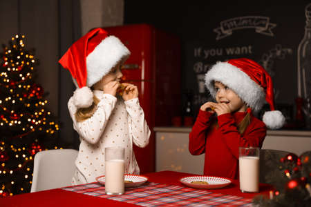 Cute little children at table in dining room. Christmas time Zdjęcie Seryjne