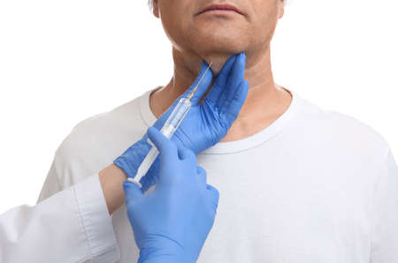 Mature man with double chin receiving injection on white background, closeup