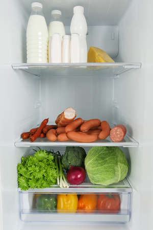 Open refrigerator full of different fresh products