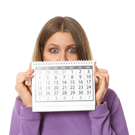 Young woman holding calendar with marked menstrual cycle days on white background
