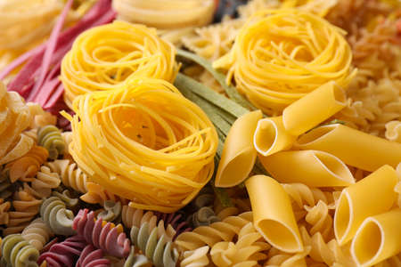 Different types of pasta as background, closeup