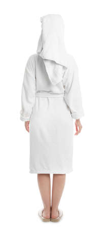 Young woman in bathrobe on white background Фото со стока