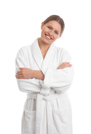 Young woman in bathrobe on white background