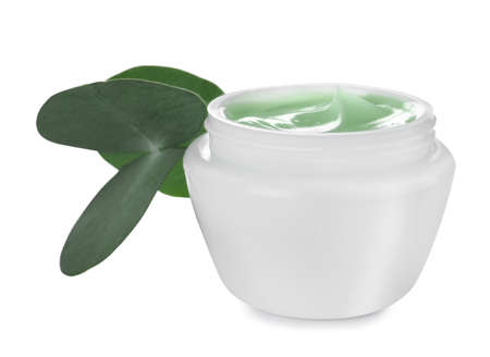 Jar of organic cream and leaves isolated on white