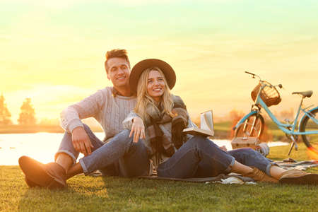 Happy young couple spending time together on picnic outdoors Archivio Fotografico