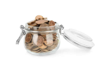Glass jar with coins isolated on white