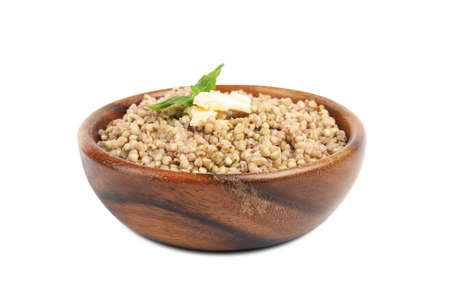 Tasty buckwheat porridge with butter isolated on white