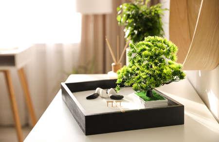 Beautiful miniature zen garden on white table indoors