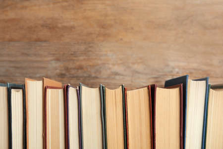 Collection of old books on wooden background