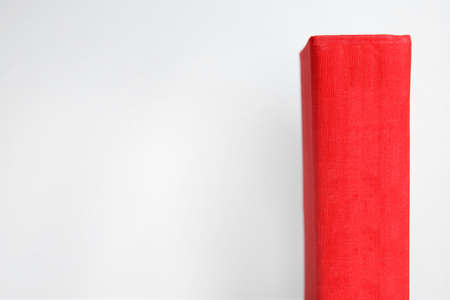Old red book on light background, space for text