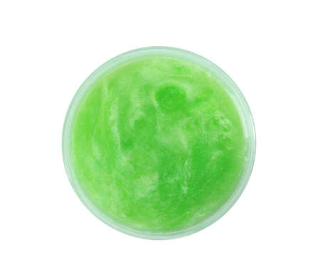 Green slime in plastic container isolated on white, top view. Antistress toy