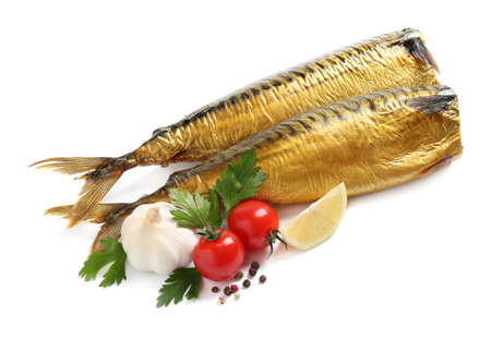 Tasty smoked fish with vegetables and lemon on white background