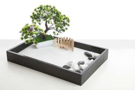 Beautiful miniature zen garden isolated on white