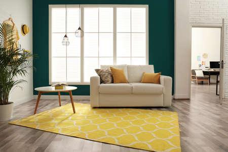 Modern comfortable sofa in stylish home interior Archivio Fotografico