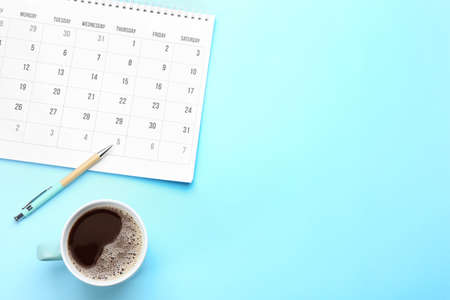Flat lay composition with calendar on light blue background. Space for text