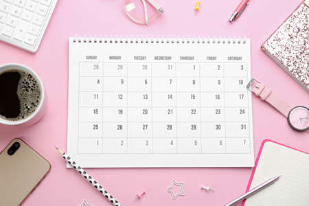 Flat lay composition with calendar on pink background Reklamní fotografie