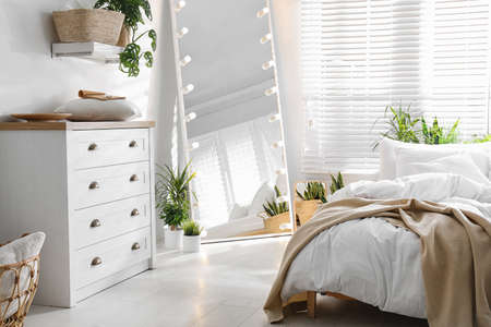White chest of drawers in beautiful bedroom. Interior design