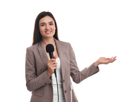 Young female journalist with microphone on white background