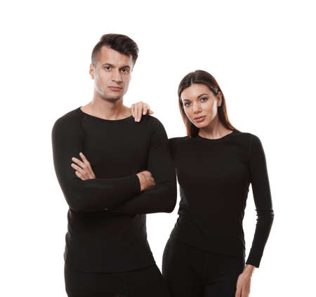 Couple wearing thermal underwear isolated on white