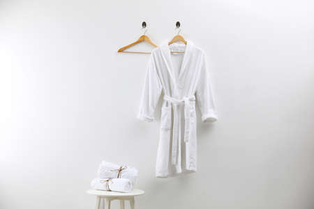 Soft comfortable bathrobe and fresh towels indoors