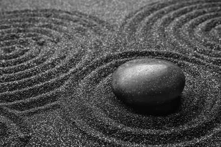 Black sand with stone and beautiful pattern. Zen concept