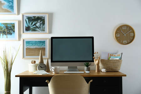 Modern computer and office supplies on wooden table, space for text. Designer's workplace