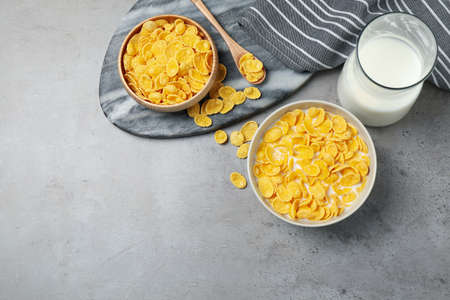 Flat lay composition with tasty corn flakes on light grey table
