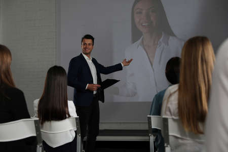 Video conference with female business trainer in office