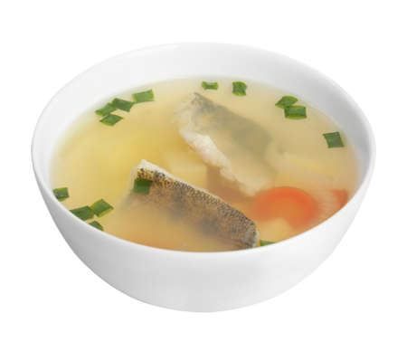 Delicious fish soup in bowl isolated on white