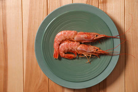 Fresh royal shrimps on wooden table, top view