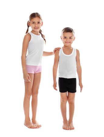 Cute little children in underwear on white background Stockfoto