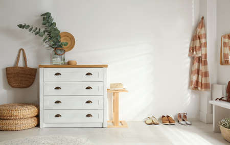 Chest of drawers in stylish room interior